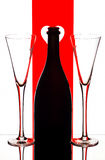 Champagne flutes & bottle. Champagne flutes and bottle with graphic background royalty free stock photos