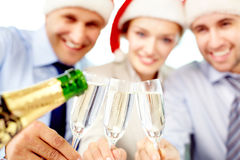 Champagne flutes. Business team holding glasses of champagne, the focus is on flutes Stock Photos