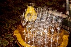 Champagne Flutes con succo d'arancia fresco Immagine Stock