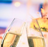 Champagne flutes with golden bubbles on flowers background, wedding and valentine day concept Royalty Free Stock Photography