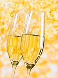 Champagne flutes on golden light background, luxury concept Royalty Free Stock Image