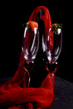 Champagne flutes & strawberry. Two champagne flutes and strawberries royalty free stock photo