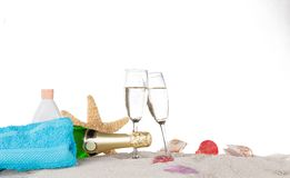 Champagne flutes on sunny beach Royalty Free Stock Photo