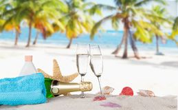 Champagne flutes on sunny beach Royalty Free Stock Photography
