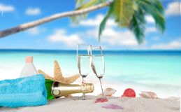 Champagne flutes on sunny beach Stock Photography