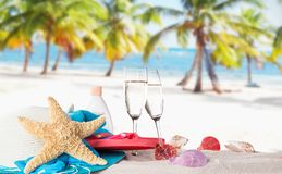 Champagne flutes on sunny beach Stock Photo