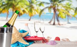 Champagne flutes on sunny beach Royalty Free Stock Image