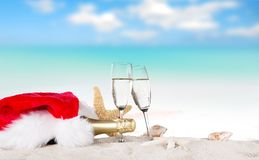 Champagne flutes on sunny beach Royalty Free Stock Photos