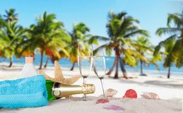 Champagne flutes on sunny beach Stock Photos