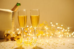 Champagne flutes on table decorated with streamer and gold confe Stock Photo