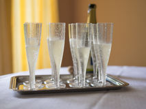 Champagne flutes on a table restaurant Royalty Free Stock Image