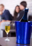 Champagne in focus, couples in background Stock Image