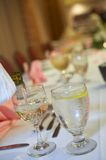Champagne at formal dinner. Champagne being poured at formal dinner party or wedding reception Stock Photo