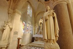 Interior of a small catholic church in Champagne, France. wide view stock photos