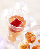 Champagne fruit cocktail and smoked salmon toasts Stock Photography