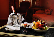 Champagne and fruits Royalty Free Stock Photos