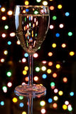 Champagne with garland on the background Stock Photo