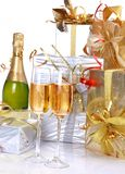 Champagne and gift. Alcohol, anniversary, background Stock Images