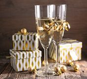 Champagne and gift box Stock Image