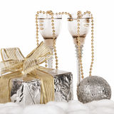 Champagne, gift box, snow, christmas toys and fir-tree Royalty Free Stock Photo