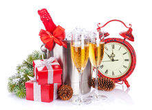 Champagne, gift boxes and christmas clock Stock Photography