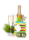 Champagne, gift and christmas decor Royalty Free Stock Photo