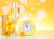 Champagne, gift clock showing time about midnight Royalty Free Stock Photography