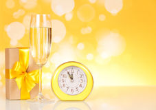 Champagne, gift clock showing time Royalty Free Stock Photo