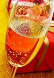 Champagne and gifts Royalty Free Stock Images
