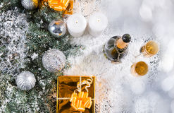 Champagne and Gifts in Snowy Christmas Still Life Royalty Free Stock Photo