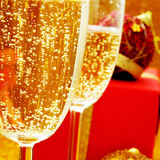 Champagne and gifts. Some glasses with champagne and some gifts Royalty Free Stock Photos