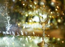 Champagne-Glas und goldenes bokeh Stockfotos