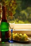 Champagne, Glas und Trauben Lizenzfreie Stockfotografie