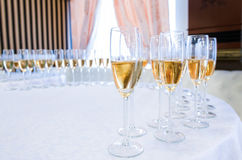 Champagne in the glases on the round table Stock Photo
