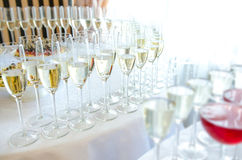 Champagne in the glases on the table Royalty Free Stock Image