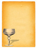Champagne glass against paper Stock Images