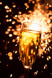 Champagne glass against sparkler background Royalty Free Stock Photography