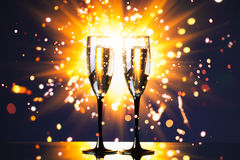 Champagne glass against sparkler background Royalty Free Stock Photos