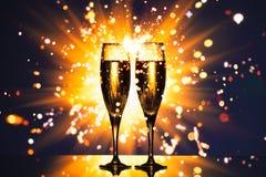 Champagne glass against sparkler background stock image