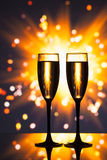 Champagne glass against sparkler background Royalty Free Stock Photo