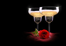 Champagne glass on black and red silk with flower Royalty Free Stock Photography