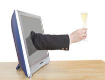 Champagne glass in businessman hand leans out TV Royalty Free Stock Photo