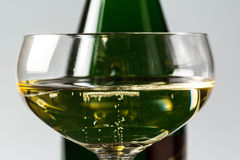 Champagne glass with champagne bottle Royalty Free Stock Photography