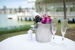 Champagne and a glass of champagne on the table for the wedding royalty free stock images