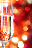 Champagne in glass at the christmas background Royalty Free Stock Photos