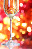 Champagne in glass at the christmas background Royalty Free Stock Photography