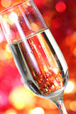 Champagne in glass at the christmas background Stock Photos