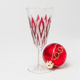 Champagne glass with Christmas ball Royalty Free Stock Photos