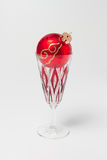 Champagne glass with Christmas bauble Royalty Free Stock Photos