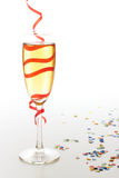 Champagne glass. With christmas confetti Stock Images